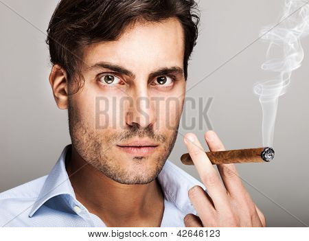 Portrait of a confident man smoking a cigar