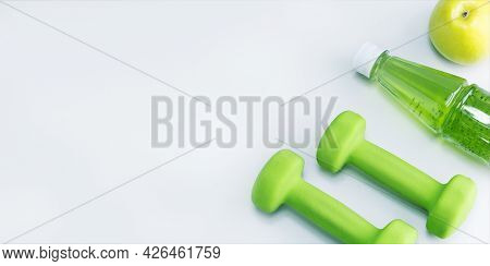 Healthy Sport And Diet Concept. Organic Food And Sport Equipment On Grey Surface. Banner.