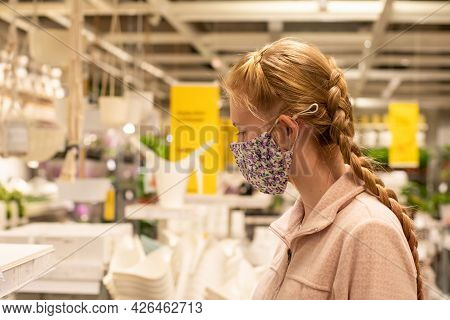 A Girl Wearing Face Mask In Department Store During Covid-19 Pandemic. Mandatory Face Masks In Nsw A