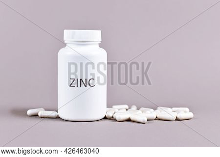 Bottle With Zinc Mineral Supplement Inscription With Capsules