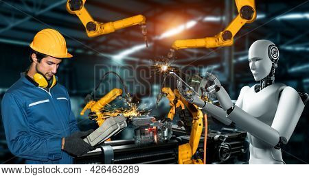Mechanized Industry Robot And Human Worker Working Together In Future Factory . Concept Of Artificia