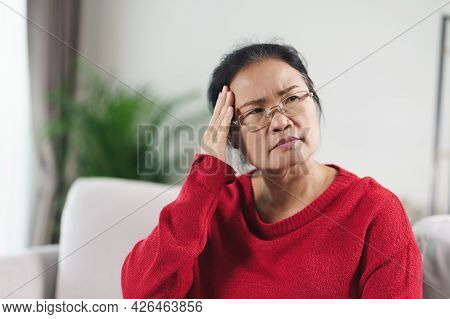 Exhausted Tired Depressed Stressed Thoughtful Mature Senior Woman Suffering From Headaches, Brain Di