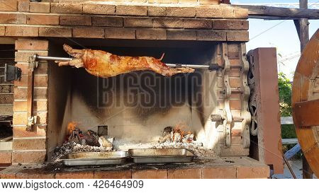 Spit Roasted Lambs, Traditional Way Of Roasting Lambs On A Rotisserie Spit In Bulgaria. Cheverme..