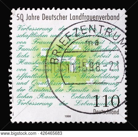 ZAGREB, CROATIA - AUGUST 29, 2014: A stamp printed in Germany shows Association Manifesto, 50th anniversary of German Rural Women's Association, circa 1998