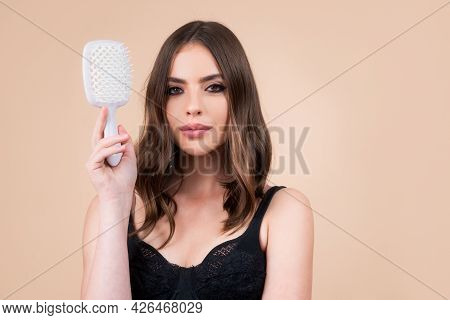 Woman Brushing Straight Natural Hair With Comb. Girl Combing Beautiful Long Healthy Hair With Hairbr
