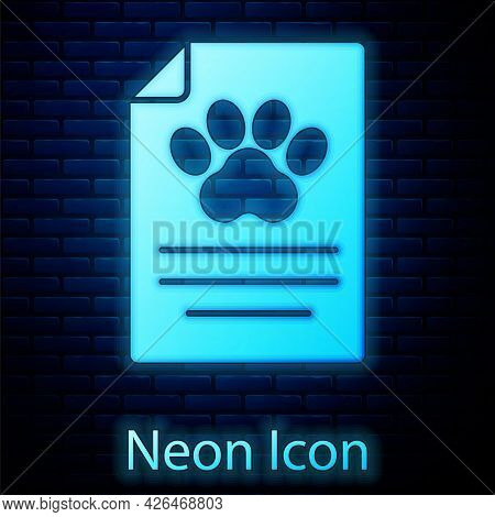 Glowing Neon Clipboard With Medical Clinical Record Pet Icon Isolated On Brick Wall Background. Heal