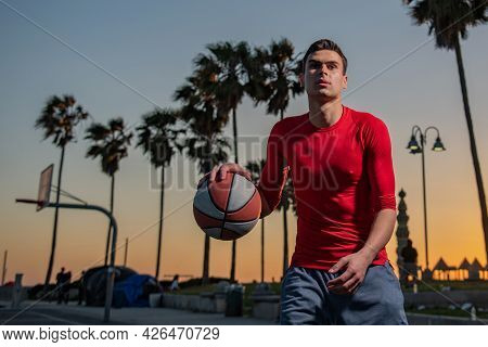 Basketball Player Shooting Ball In Hoop Outdoor Court. Urban Youth Game. Concept Of Sport Success, S