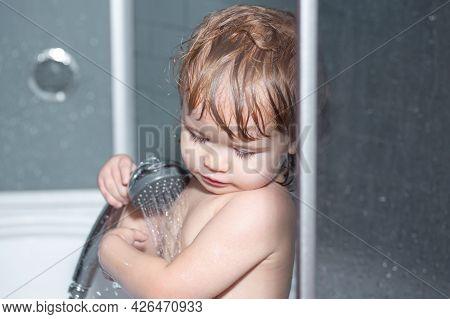 Child Bathing In Bathroom. Happy Funny Baby Bathed In The Bath.