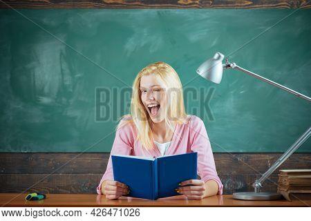 Happy Funny Teacher Winking. Teacher Leader. Student Studying In Classroom. Modern Teacher Hipster T