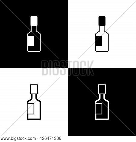 Set Tabasco Sauce Icon Isolated On Black And White Background. Chili Cayenne Pepper Sauce. Vector