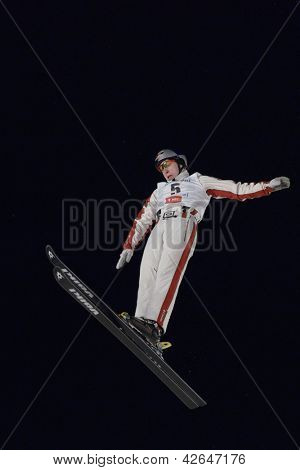BUKOVEL, UKRAINE - FEBRUARY 23: Travis Gerrits, Switzerland performs aerial skiing during Freestyle Ski World Cup in Bukovel, Ukraine on February 23, 2013.