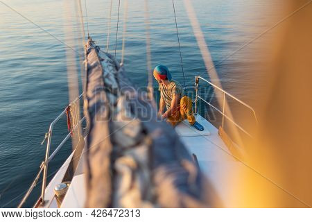 A Man Controls A Yacht. Travel By Sea. Sailboat Captain. Sailing, Tourism, Travel And People