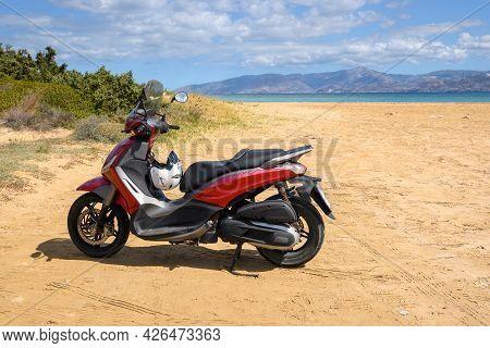 Paros, Greece - September 30, 2020: Motorbike On The Beach On The Island Of Paros. A Motorbike Is A