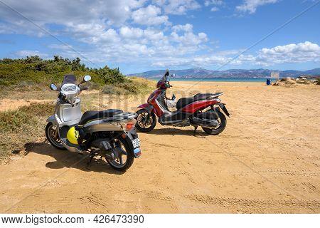 Paros, Greece - September 30, 2020: Motorbikes On The Beach On The Island Of Paros. A Motorbike Is A