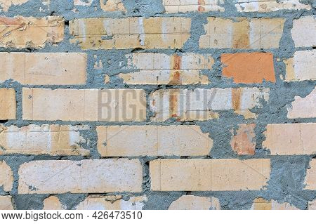 Background Of Careless Laying Of A Brick Wall Smeared With Cement Mortar. Cement Mortar Drips On A B