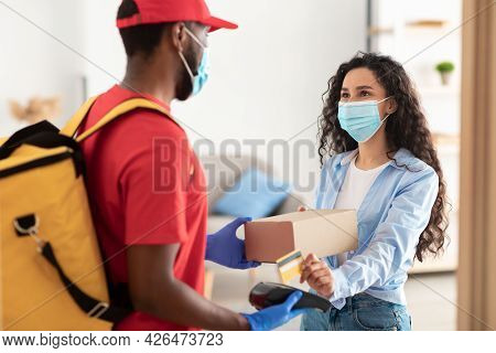 Black Man Holding Pos Machine Customer Paying With Debit Card