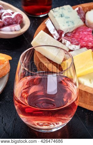 Rose Wine With Ham And Cheese. Spanish Tapas In A Bar. Food Sharing. Mediterranean Snacks On A Black