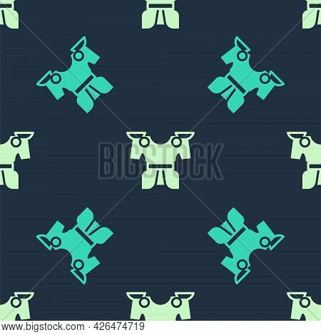 Green And Beige Body Armor Icon Isolated Seamless Pattern On Blue Background. Vector