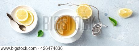 Lemon Tea In A Cup, Overhead Flat Panorama. Organic Lemons, Shot From Above. Healthy Detox Citrus Dr