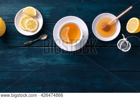 Tea With Lemons And Honey, Shot From Above On A Dark Blue Rustic Background With A Place For Text. N
