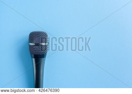 Microphone On A Colorful Blue Background Close Up. Singing, Writing Music, Karaoke Online, Creativit