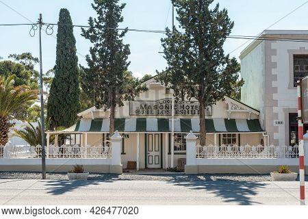 Matjiesfontein, South Africa - April 20, 2021: A Street Scene, With Logans Masonic Hotel, In The His