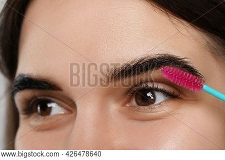 Brushing Woman's Eyebrows After Tinting, Closeup View