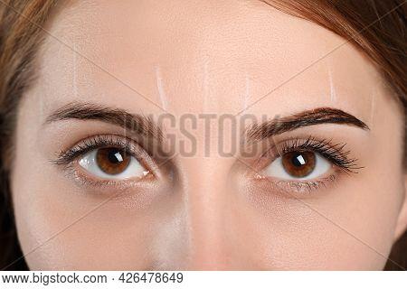 Woman During Eyebrow Tinting Procedure, Closeup View