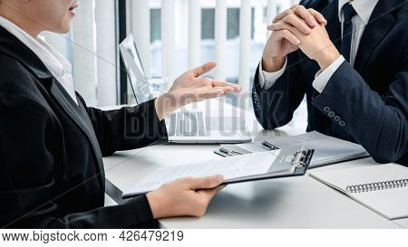 Asian Woman Holding Resume To Explaining About Her Profile And Past Work Experience To Employer Whil