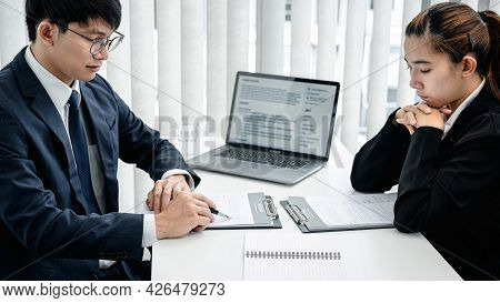 Man Employer Holding Pen To Pointing On Resume And Reading Her Profile During Asking Candidate Quest