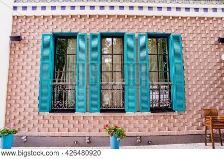 Turquoise Shutters On The Windows Of The House In Retro Style.