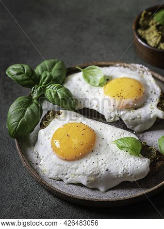 Croque-madame With Fried Egg , Pesto Sauce And Basil. Traditional French Toasted Sandwich. French Cu