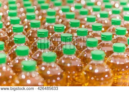 Plastic Bottles Of Cooking Oil In A Row Themed Background