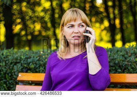 Defocus Wonderful Caucasian Blond Woman Talking, Speaking On The Phone Outside, Outdoor. 40s Years O