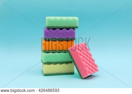 Cleaning Colorful Sponges On Blue Background. Tower Of Sponges, Minimal Style. Spring Cleaning Conce