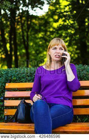 Defocus Wonder Caucasian Blond Woman Talking, Speaking On The Phone Outside, Outdoor. 40s Years Old