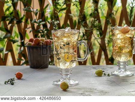 Summer Gooseberry Ice Tea With Thymes. Homemade Non-alcoholic Mocktail Or Lemonade With Ripe Berries