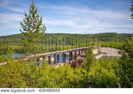 View Of Abandoned Hydroelectric Power Plant On The Taidon River In Siberia, Russia