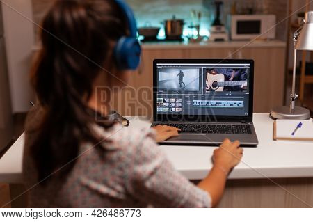 Movie Maker Editing A Film Using Modern Software For Post Production. Content Creator In Home Workin
