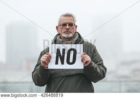 Dissenting Activist. Senior Man With Placard - No. Single Picket.