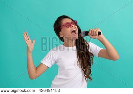 Happy Kid Singer Sing Karaoke Song To Microphone Blue Background, Music