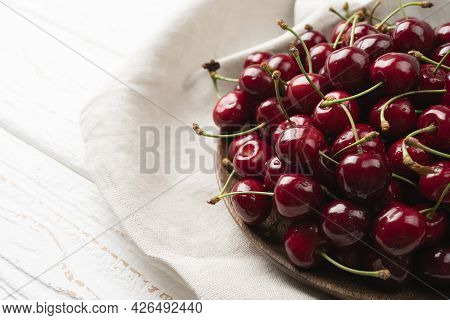 Sweet Red Cherry Berries Served On A Plate Isolated On White Background, Sweet Cherry On A Bench In