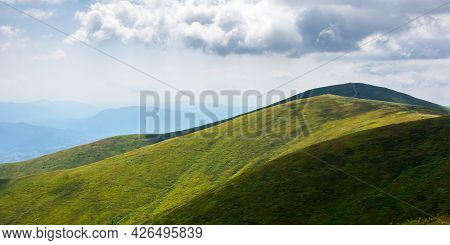 Rolling Hills An Meadows Of Borzhava Ridge. Beautiful Nature Scenery With Grassy Slopes In Dappled L