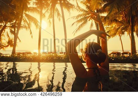 Vacation Beach Summer Holiday Concept. Silhouette Young Woman Relaxing In Swimming Pool On Summer Be