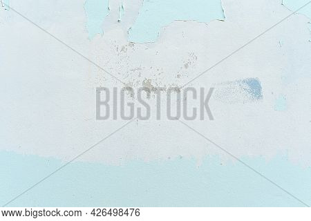 Pale Color And Peeling Of Painted Green White Cement Wall Texture Background. Old Weathered Painted