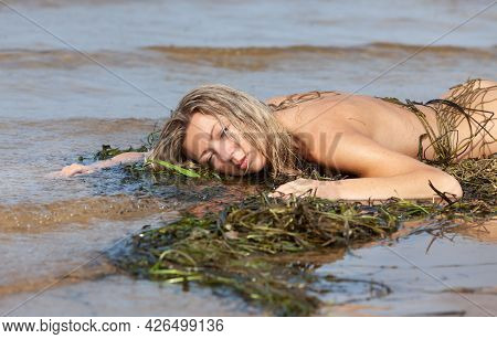 Nude Woman And Fishing Net