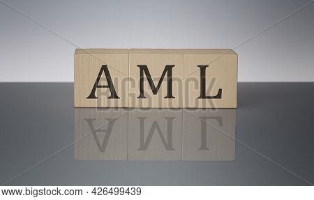Money Laundering Concept, Wooden Word Block Aml On The Grey Background
