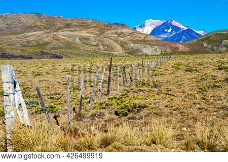 Los Glaciares is Argentina's most beautiful natural park. Dirt rocky road. Pampas surround the snow-capped mountains. Argentina, Patagonia. Pampas of South America