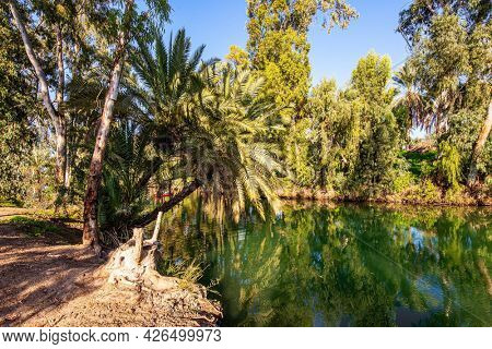 Israel. Wonderful walk along the river. The fine winter sunny day. The Jordan River is the most famous river in the world. Jordan is the place of the baptism of Christ.