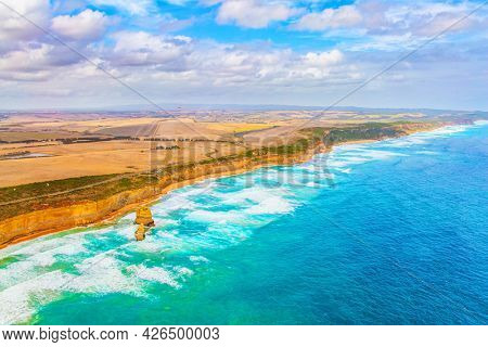 Aerial view. Great Ocean Road. Helicopter flight over the scenic Pacific coastline. Australia.The Twelve Apostles are a group of limestone rocks in the Pacific Ocean near the coast.